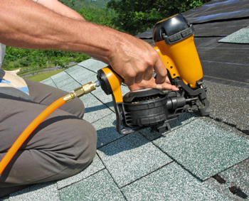 one of our roofers is installing new shingles